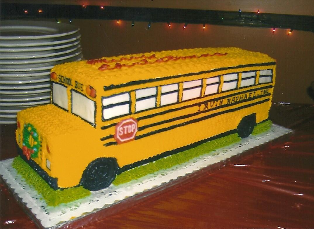 Celebration cake shaped like a school bus.