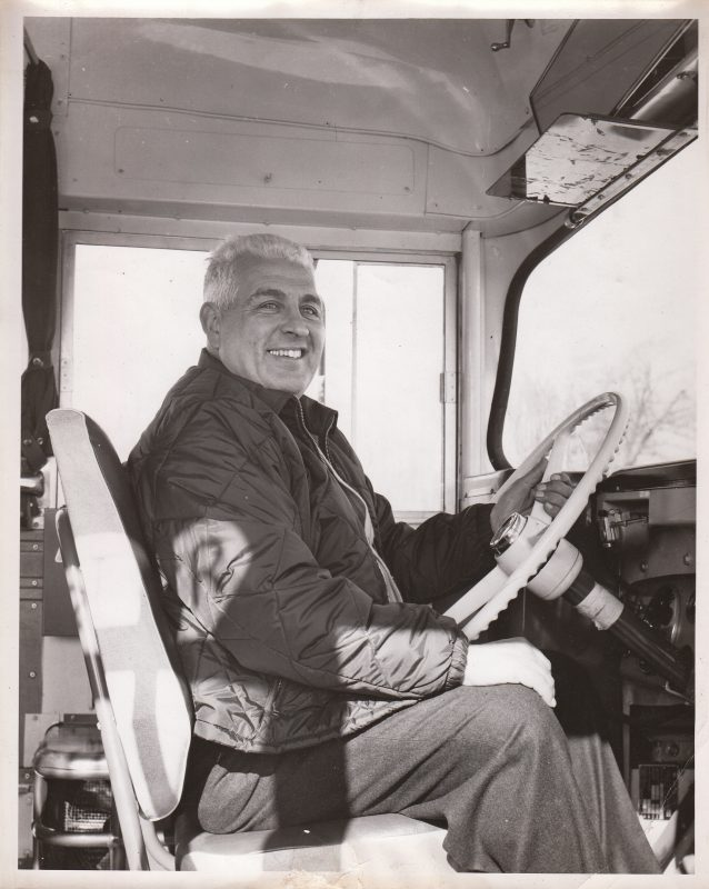 Founder Irvin Raphael behind the wheel of a bus