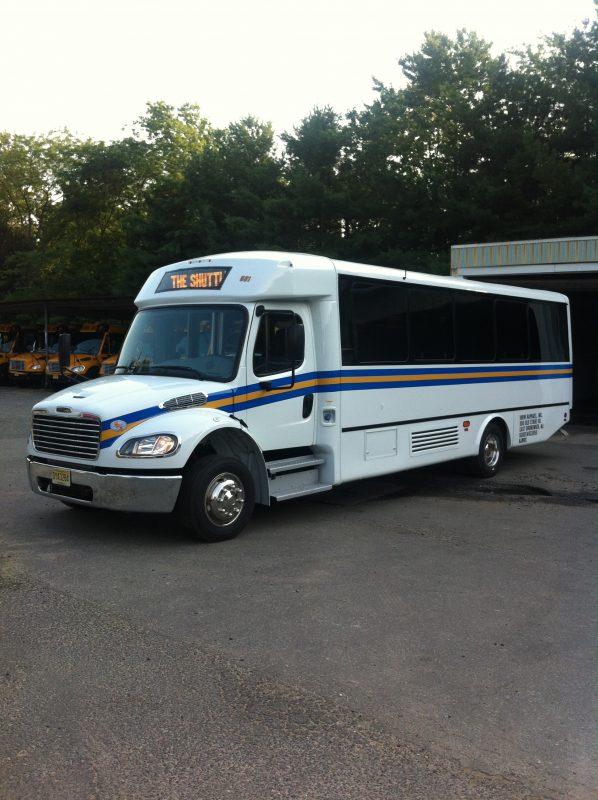 A white shuttle bus.